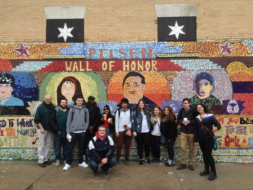 Students in front of a mural in the Pilsen neighborhood of Chicago on the March 2019 Chicago field trip. Jessica Abdelnour is first on the right.