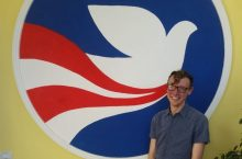 Carlson with Peace Corps logo