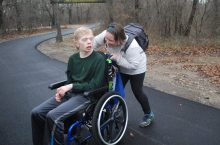 Veronique Parmenter with camper at Camp Summit during Alternative Spring Break.