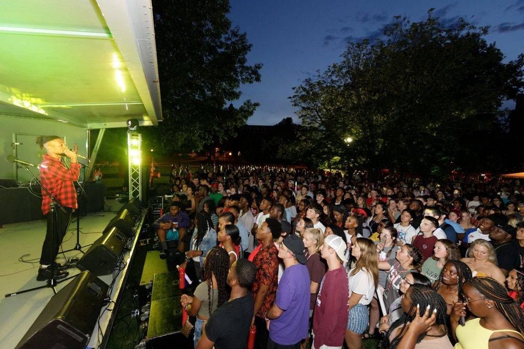 ISU students watching performer on the Quad.