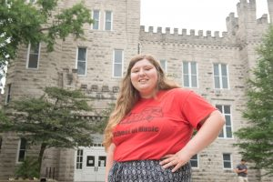 McLean County Full Tuition Scholarship winner Maddie Adelman stands in front of Cook Hall