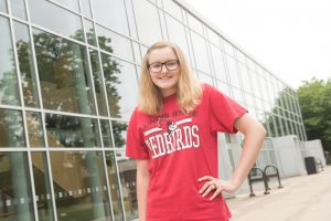 McLean County Full Tuition Scholarship winner Shelby Enghausen stands in front of the Center for Performing Arts