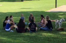 CSD students and staff converse in a small group.
