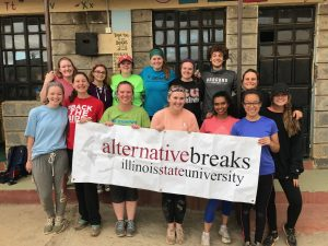 Group picture with Alternative Breaks banner