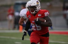 Running back James Robinson carrying the football