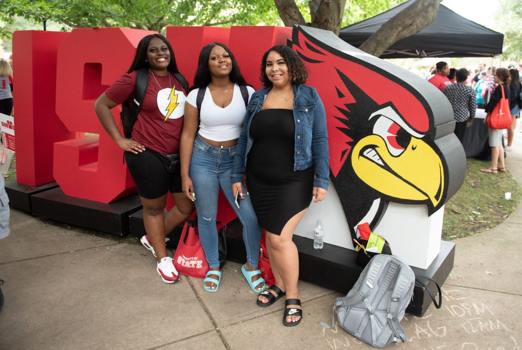 Students in front of ISU letters.