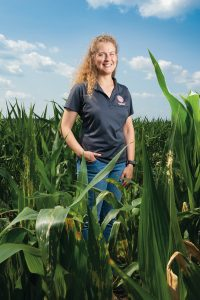 Maria Boerngen, an assistant professor in Illinois State University's Department of Agriculture in cornfield