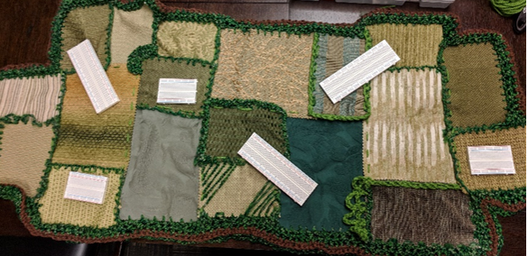 Togographic Tapestry representing fields in St. Aubin's art piece, Windstorm