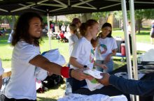 Students and staff distribute t-shirts to promote the new Eight at State wellness campaign