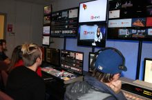 Students in TV-10 studios looking at monitors.
