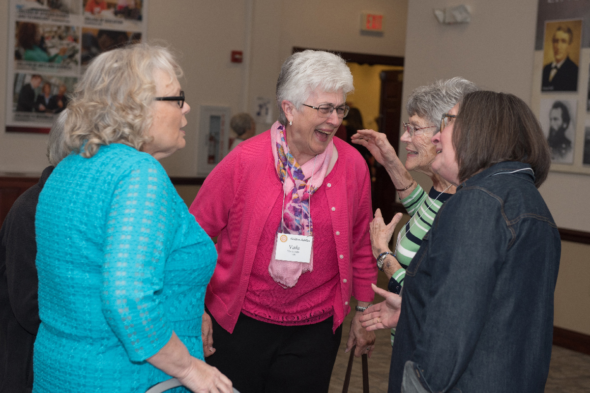 Vada Saffer '69 shares a laugh with fellow MCN alumni.