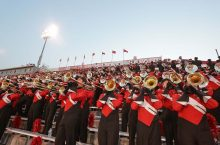 Big Red Marching Trombone Section in stands at Handcock Stadium