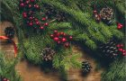 wreath and holly and pine cones