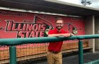 Person standing in Illinois State baseball dugout