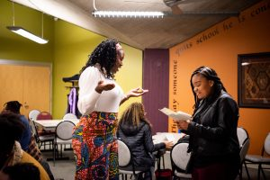 Candice Halbert '01 answers a question for 2019 Charles STEM Scholarship winner Ciara Newman at Thursday's STEM Social program in the Vrooman Center