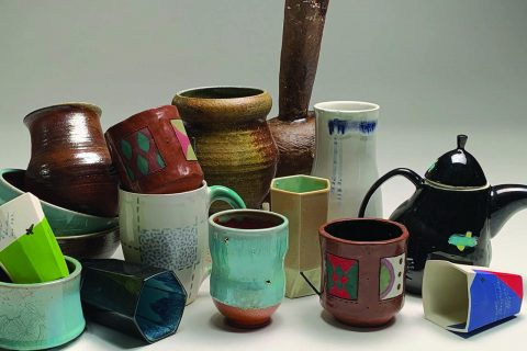 Photo of a variety of ceramic artwork including cups, mugs, vases, teapots, and others