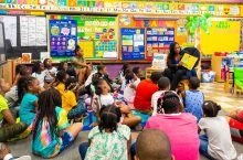 Janice Jackson reads to Auburn Gresham Gold summer camp participants
