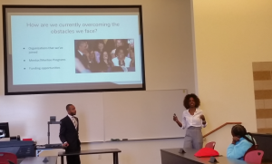 Two people present on navigating educational field.