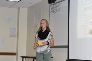 Exercise science major Maggie Burris presents on her group's project for the YWCA Labyrinth.