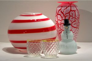 glasses, vases, and a snowman made from glass