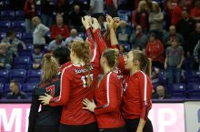 Volleyball players huddle