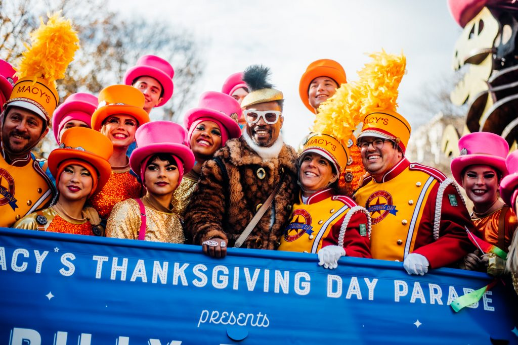 """Gamma Phi Circus posing with Billy Porter at the parade. Gamma Phi Circus in front of the Coach float at Macy's Thanksgiving Day Parade """"(Porter) is a larger than life character for sure,"""" Marcus Alouan said. """"We did see him at the rehearsal for our first run through. And then he was there for the parade and we were able to get a couple of shots with him."""" (Photo courtesy of Coach and by Alyssa Greenberg)"""