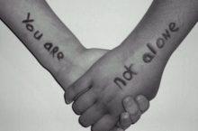 You are not alone on two arms with hands holding
