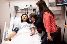 Keith Habersberger practices nursing on simulation manikin