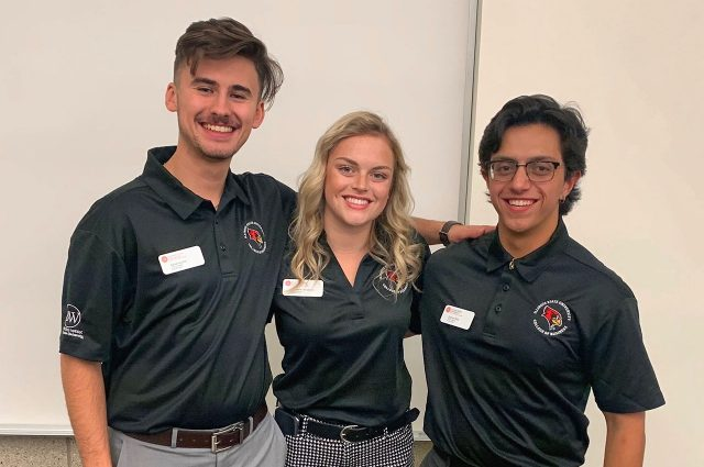 Student leaders Adrian Kuzbik, Shannon Donaldson, and Estevan Mora at the Corporate Social Responsibility Case Competition