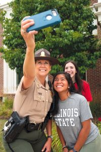 Troop Tracy taking a selfie with two ISU students