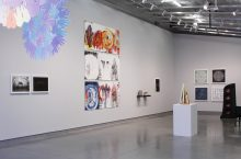 art pieces line the walls and sculpture on pedestals in the galleries