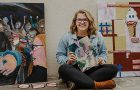 Art student Emily Minton poses with her artwork