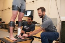 Student and professor studying ankle braces.