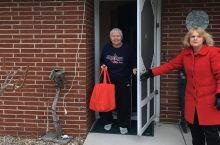 Woman delivers care package to another woman