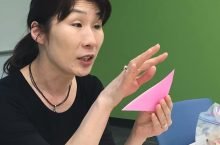 woman explaining origami