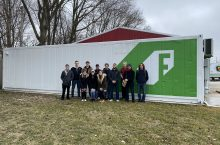 The group visiting a shipping container farm in Champaign.