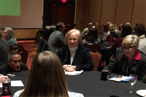Dr. Lamonica seated at a round table discussion at the 2020 Teaching & Learning Symposium