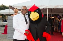 Donor Richard Greenfield poses with Reggie Redbird
