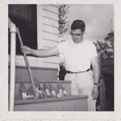 A picture of Bob Maske taken at 313 North Street in Normal. He found morrel mushrooms under the steps.