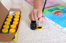 Child mixing paints