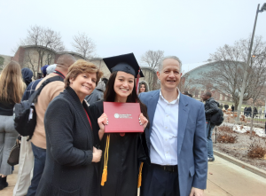 Faith with parents Helene and Gerard Fosco at the 2019 commencement ceremonies.