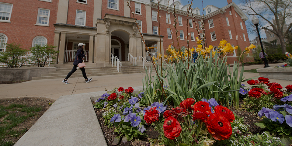 person walking in front of Fell Hall