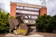 Abstract Variations sculpture by Ernest Trova with DeGarma Hall in the background