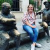 Emilee Baldwin '19 sits with statues of Don Quixote and Sancho Panza before her Fulbright orientation in Spain.