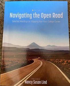 book cover showing an stretch of highway with mountains in the distance