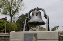 Founders Bell on Quad with LGBTQ drape on it