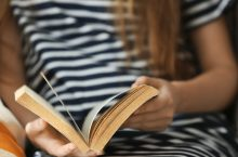 Woman reading book, close up