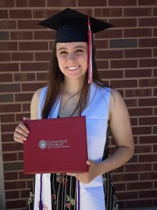 Illinois State biology teacher education graduate Megan Tunney '20 holding diploma