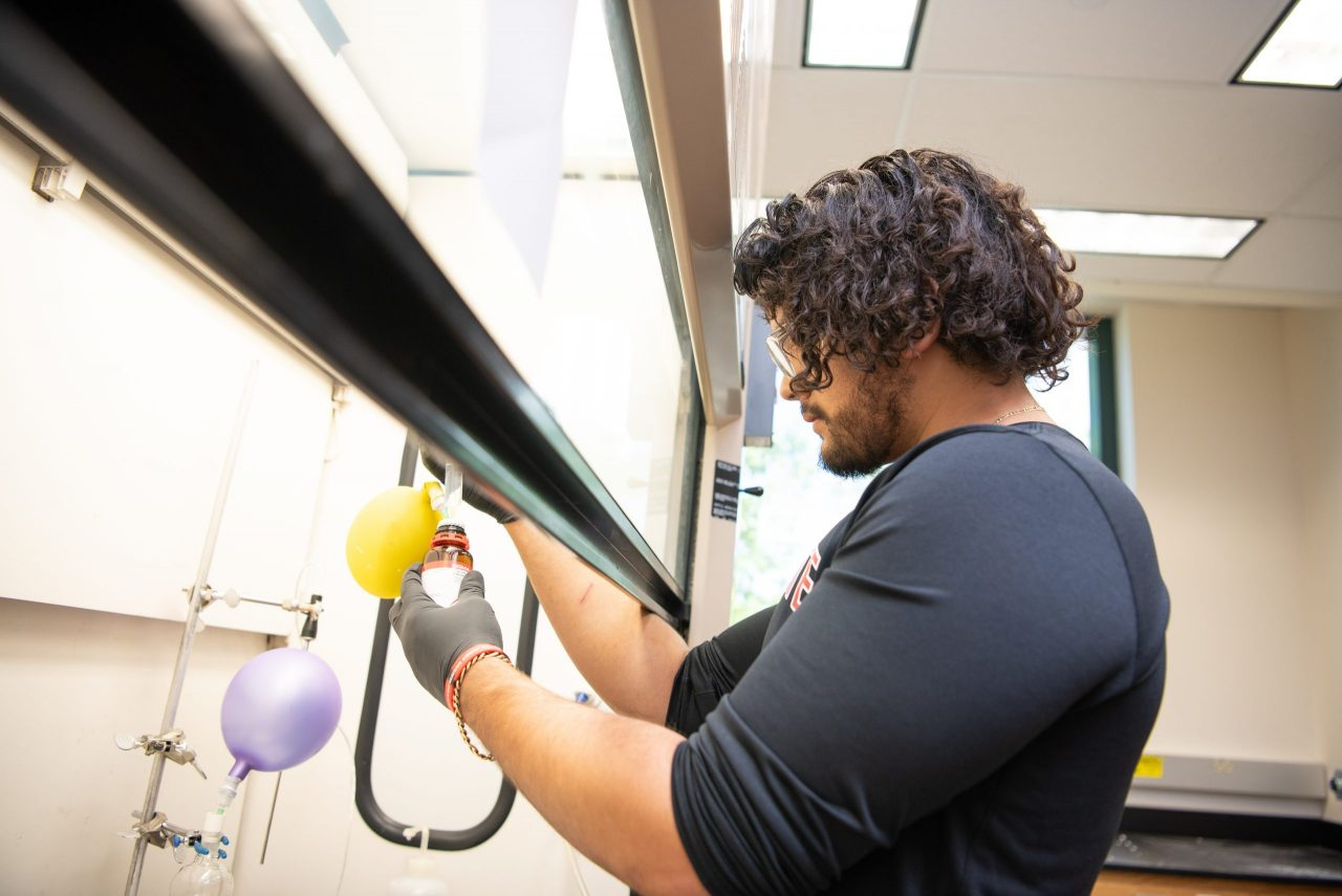 Juan Canchola working in the lab of Dr. Jonathan Mills in the Science Lab Building