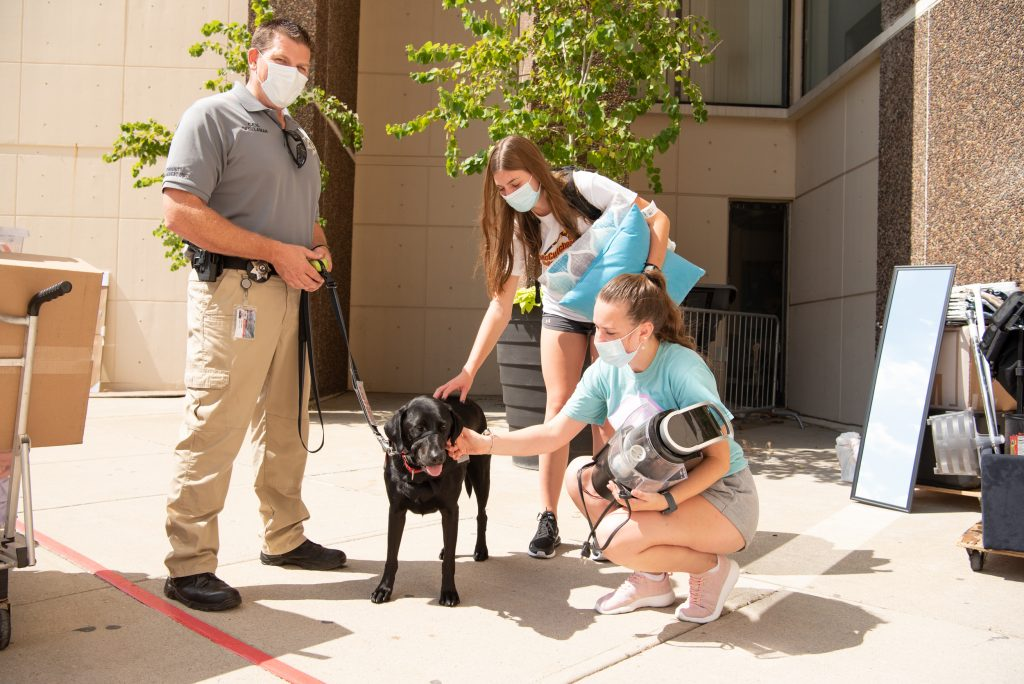 Pawfficer Sage meets with a family during move-in.
